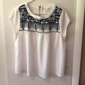 White and navy top